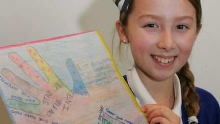 Chloe Austin, age nine winner of the poster competition, from Branfil Primary School, designed poste