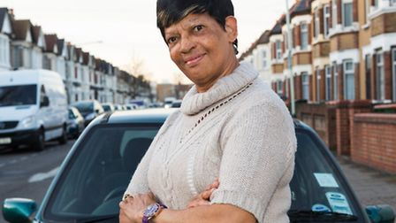 Sylvian McMillan, aged 70 outside her car near Harold Road in Upton Park. Sylvian was given a parkin