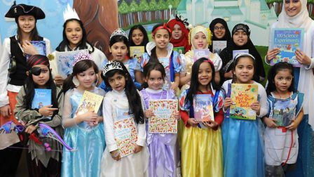 Staff and students at Quwwat-Ul-Islam girls school celebrate world book day