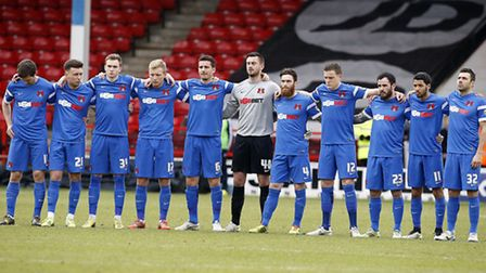 Orient players observe a minutes silence at Walsall (pic: Simon O'Connor)