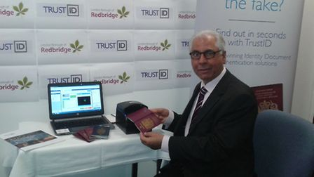 Redbridge Council's cabinet member for housing Muhammed Javed using new passport scanners