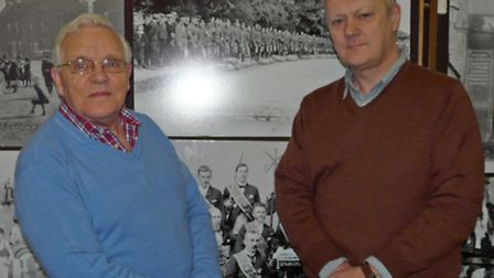 Harry Gray (left) and Alan Hendry in front of a photograph in Wick Heritage Museum showing soldiers