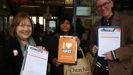 Lesli Miller, Gulsie Suleman and Martin Ledwick outside Ilford Railway Station encouraging members o