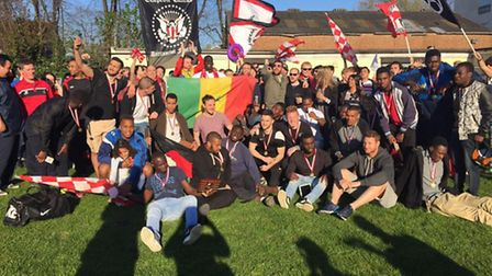 The Clapton fans celebrate after Stansted game (pic: Keely Moore)