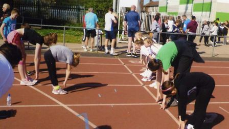 Participants warm up on the starting line