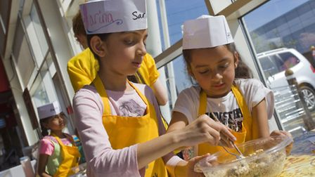 Sarina, seven, and Amiya, six, learn to create a healthy, nutritious meal from scratch at the Lets C