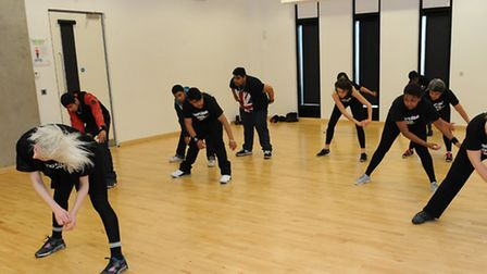 Reporter Anna Silverman learning the choreography to Missy Elliot's Get Your Freak On