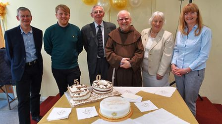 Father Francis Conway with his 50th anniversary cake.