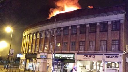 Flames could be seen above the building. Picture: David Stainer