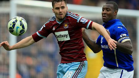 West Ham United's Carl Jenkinson and Leicester City's Wes Morgan compete for the ball during the Bar