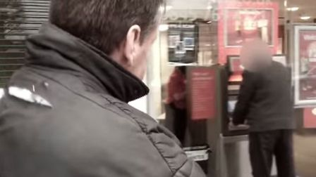 Still from police crime prevention video - cashpoint