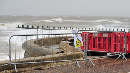 The North Sea crashing into the seafront on wet and wild day in Lowestoft.