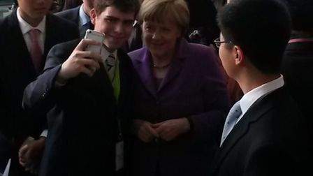 """Matheus grabs a """"selfie"""" with Angela Merkel at the J7 Youth Summit (Pic by Unicef)"""