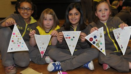 Carmen Frowde-Eaton, Holly McCallum, Ella Grace Roaas and Olivia Joiner with the bunting they made