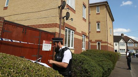 Police outside a flat off Grove Road in Chadwell Heath which is now a crime scene after a suspected