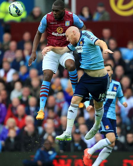 Aston Villa's Christian Benteke (left) and West Ham United's James Collins battle for the ball durin