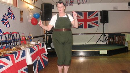 Lin Reynolds, a member of the Elm Park Royal British Legion, dressed as a Land Army girl at the bran