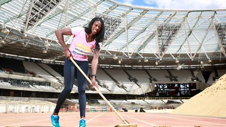 World 400m Champion Christine Ohuruogu sweeps away the final protective layer of soil from the finis
