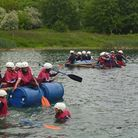 The children of Eastcourt School in Goodmayes on a raft they built themselves at Stubbers Adventure