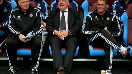 West Ham United manager Sam Allardyce (centre) with assistant Neil McDonald (left) and first-team co