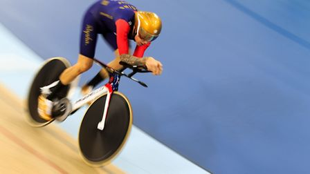 """""""Wiggo"""" sports a gold helmet and shoes during the hour challenege. Picture: John Walton/PA Wire"""