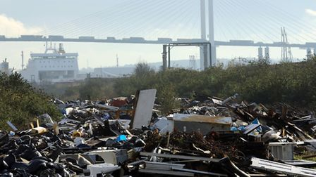 An illegal fly tip site alongside the Thames estuary at Purfleet in Essex.