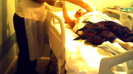 An extract of a video where Bridget Rees holds her hands up to nurse Grace Bello during her time at