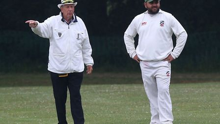 Ilford's Shaz Hafeez shares a joke with an umpire on his return to former club Harold Wood (pic: Gav