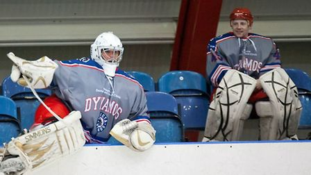 New London Raiders goalie Davey Jackson (right) looks on as Chris Douglas takes to the ice for Invic