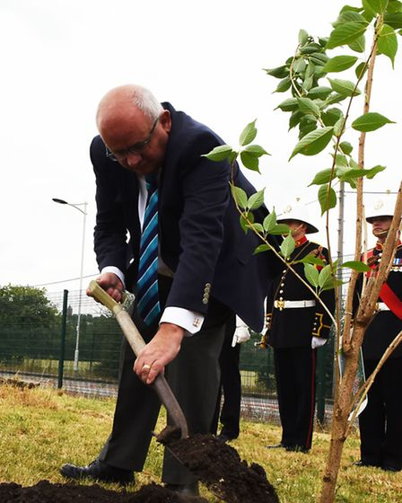 """Cllr Paul Canal planting a tree in Wanstead Rugby Club's """"Avenue of Remembrance"""""""