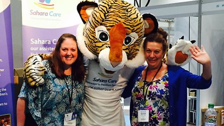 Visitors meet the Sahara Care tiger at the Autism Show