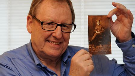 Paul Oliver with a photograph of his father Harry (Henry) Oliver, who survived the First World War