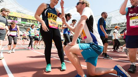 Matt Simpson proposes to Katie Perry on the finish line at the Great Newham London Run in Queen Eliz