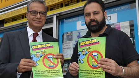 Cllr Dev Sharma and Jagvinder Singh with the posters