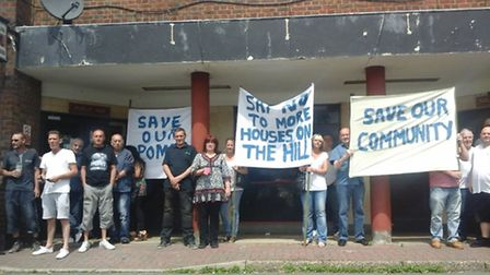 Pubgoers protesting the demolition