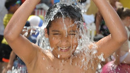 """Mohammed Iqbal, 12, cools off on the """"beach"""" at the Mayor's Show"""