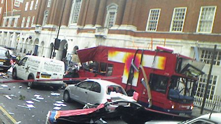 The scene in London's Tavistock Square, after a bomb ripped through a Number 30 double decker bus. P