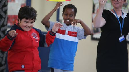 Gelro Ibrahim, 11, and Hassan Hashi, 10, taking part in a workshop