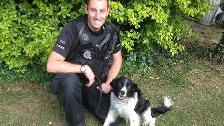 Orla the new police dog with Pc Paul Arthey.