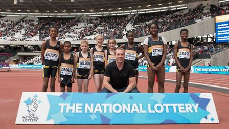 The eight youngsters from Newham and Essex Beagles with Sir Chris Hoy