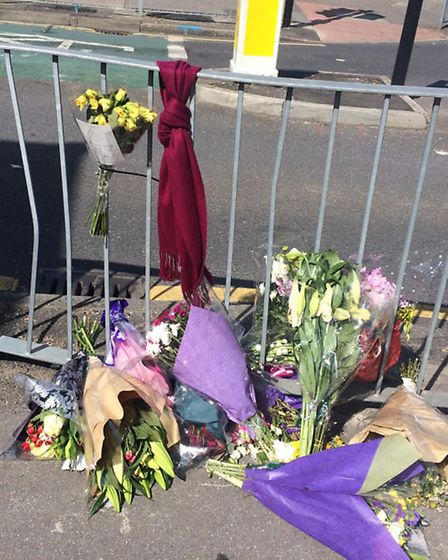 Flowers and a West Ham scarf have been placed on Albany Road on the junction with Hornchurch High St
