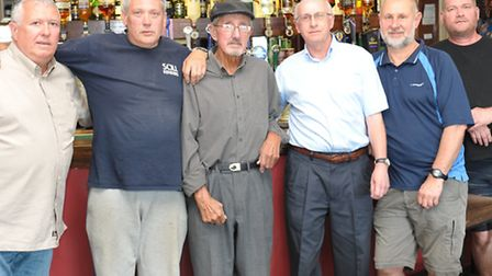 Boss Robert Goodes third right with his locals
