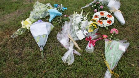 Flowers and messages at the scene of the fatal crash last year