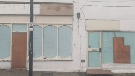 The outside of the Woodford Muslim Cultural Centre with a boarded up window, where a brick was repor
