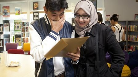 Tanweerur Siddique, 16, celebrates his GCSE results with sister Tasnima Khanom at Forest Gate Commun