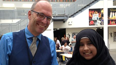 Lister Community School headmaster Anthony Wilson with star student Priya Ahmed, who scooped eight A