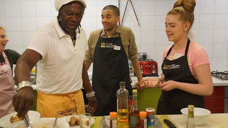 Levi Roots with youngsters from the Prince's Trust at Food Academy UK