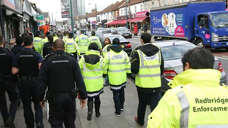 Enforcement officers from Redbridge Council and police taking part in an action day in Ilford Lane i