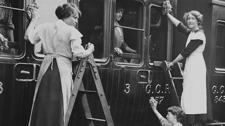 Women cleaning the smoking compartment of a steam locomotive (picture: National Railway Museum)
