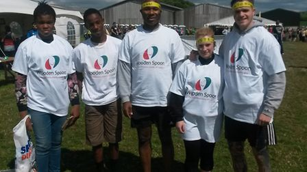Emmanuel Finndoro Obasi (second left) took part in The Total Warrior Challenge to raise money for Ca
